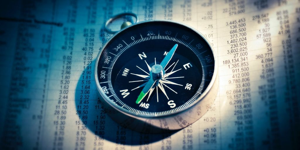 Compass Resting on Financial Planning Document